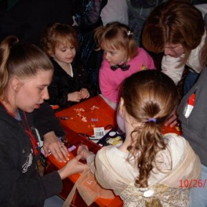 The kids decorating Trick or treat bags