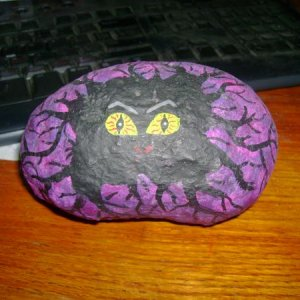 hatching monster egg painted on a rock