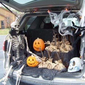 Trunk-n-Treat.  I stole the skeleton and spider from my porch.  The broom shaped goodie bags are out of a magazine. There was a 400w invertor powering