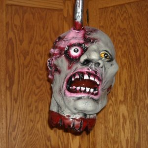 Ghoul head hanging from hook.
