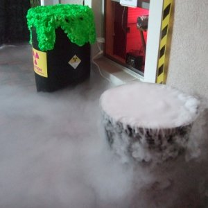 Shot of the toxic fog release vent in window with toxic waste barrel and dry ice caldron.