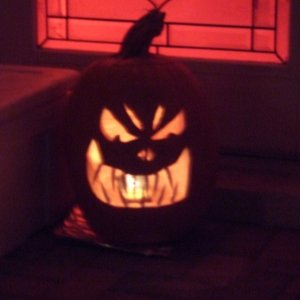 Our carved pumpkin.  This year we used plastic teeth for a different effect.