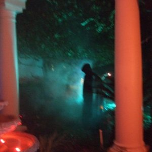 Our gravedigger with spooky lighting and ground fogger.  (Gravedigger is actually Grandinroad's vampire)